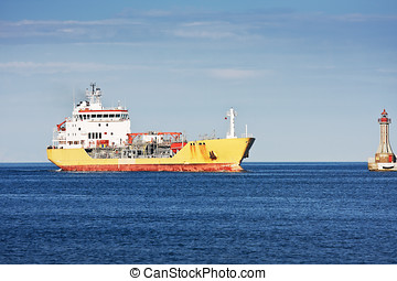 Tanker ship entering port - Large yellow and red tanker ship...