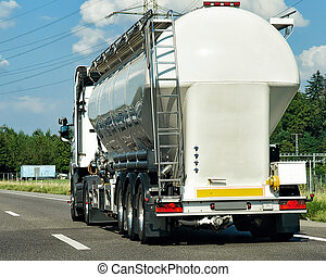 Tanker storage vessel on road in canton Geneva in...