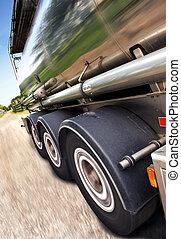 Tanker Trailer - Cropped, motion-blurred, tilted close-up of...