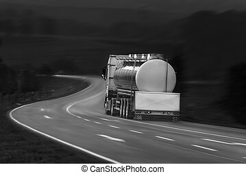 Tanker truck in motion - Black and white image with tanker...
