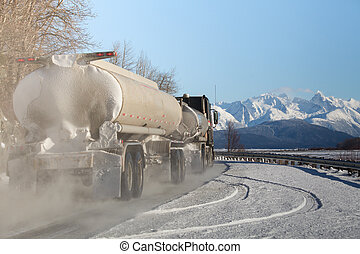 Tanker truck on Alaskan road in winter.