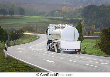 Tanker truck on the road - Big white tanker truck drives on...