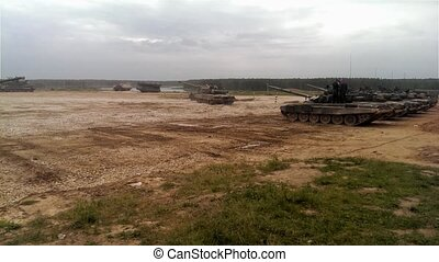 Tanks on a battlefield - Tanks go and stop at the military...