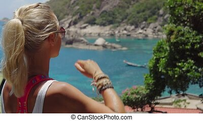 Tanned sporty female admire the gorgeous Tanote Bay on sunny...