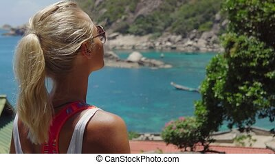 Tanned sporty female enjoy gorgeous view of Tanote Bay on...