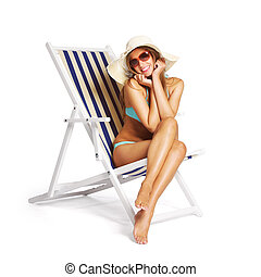 Beautiful young woman relaxing on beach chair, white background