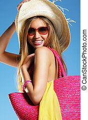 Tanned woman - Tanned smiling woman against blue background