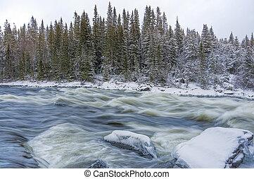 Tannoforsen waterfall in Sweden in winter