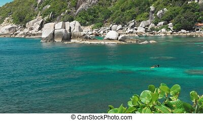 Tanote Bay on sunny day. Rippled ocean water over...