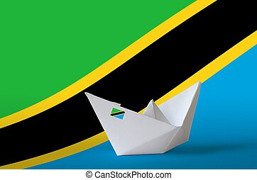 Tanzania flag depicted on paper origami ship closeup. Handmade arts concept