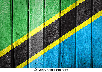 Tanzania Flag on old wood background