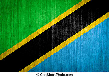 Tanzania Flag on wood background