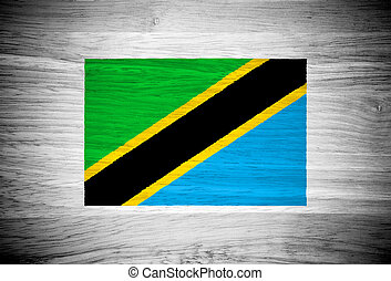 Tanzania flag on wood texture
