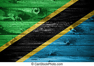 Tanzania flag on wooden planks background