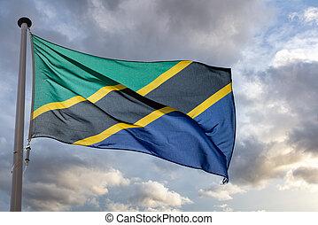 Tanzania flag waving against cloudy sky