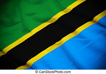 Wavy and rippled national flag of Tanzania background.