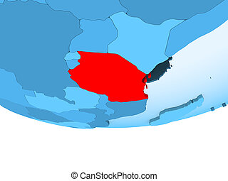 Tanzania in red on blue map