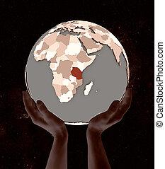 Tanzania on globe in hands