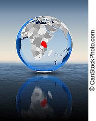 Tanzania on globe in water