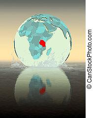 Tanzania on globe splashing in water