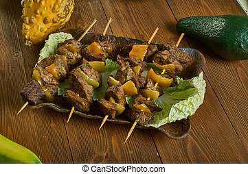 Mshikaki, street food dish , skewered pieces of marinated meat such as beef, goat, or mutton, Tanzanian cuisine, Traditional assorted African dishes, Top view.