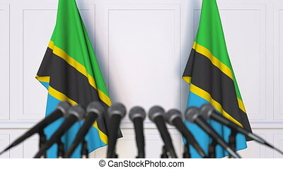 Tanzanian official press conference. Flags of Tanzania and...