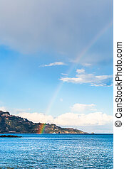 Taormina cape and rainbow in Ionian Sea in spring, Sicily