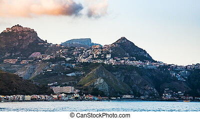 Taormina city and Giardini Naxos town in evening - travel to...