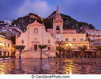 The famous main square of Piazza April IX in Taormina at sunrise. Italy. Sicily.