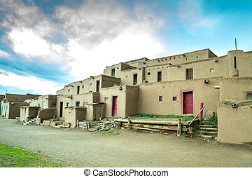 Taos Pueblo - adobe settlemenets of native Americans. -...