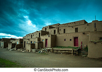 Taos Pueblo - adobe settlemenets of native Americans. -...