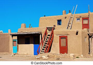 Taos Pueblo - Bright colorful doors of ancient Taos Pueblo,...