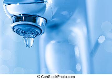 Tap closeup with dripping waterdrop. Water leaking, saving...