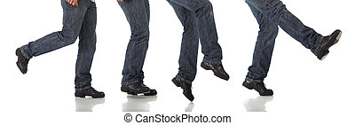 Tap Dancer - Tap dancer in blue jeans and tap shoes doing...