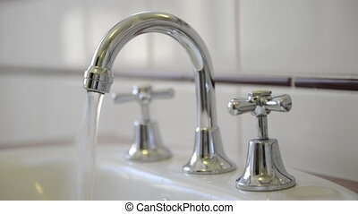 Tap Running Water - water running from a chrome tap faucet