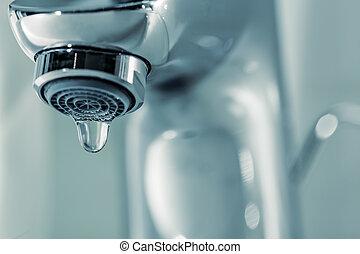 Tap with dripping waterdrop. Water leaking, saving. - Tap...