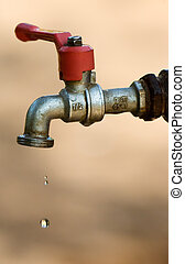Image shows a tap dripping water against a dry background