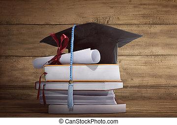 tapa graduación, con, graduación, papel, en, un, pila, de, libro