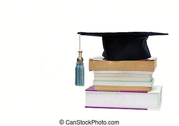tapa graduación, encima de, un, montón libros