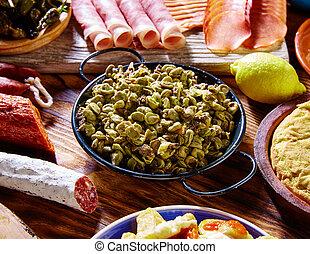 Tapas habas con morcilla lima beans Spain