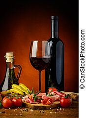 Tapas, ham and red wine - still life with traditional tapas,...