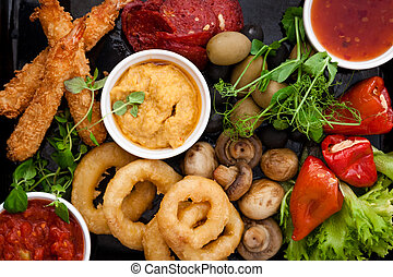 Tapas Selection (filled pepperoni, shrimps, mushrooms, ...
