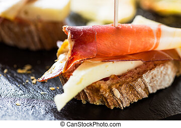 Tapas - Spanish tapas: slice of bread, cheese and spanish...