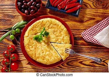 Tapas tortilla de patata potatoes omelette in wooden table...