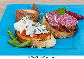 Tapas with cheese and salami