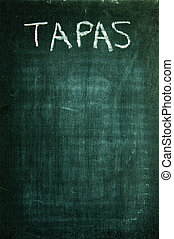 tapas written with a chalk on a blackboard