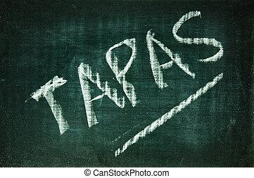 tapas written with a chalk on a blackboard