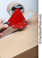 Tape Gun Dispenser packaging a box