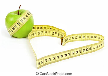 Tape measure heart shape and green apple - health, weight ...