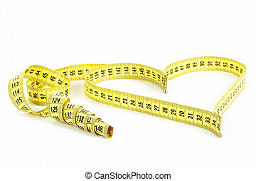 Tape measure heart shape - health, weight concept